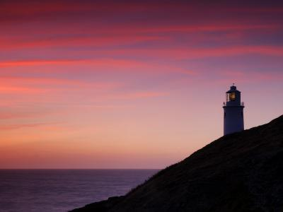 Trevose Lighthouse at Sunset, Near Padstow, Cornwall, Uk. July 2008-Ross Hoddinott-Photographic Print