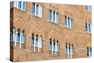 Europe, Italy, Siena. Detail of Arches Building Facades Il Campo