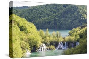 Plitvice National Park cascades step down from lower lake Kozjak to smaller lakes. by Trish Drury