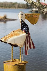 USA, Alabama. Whimsical pelican sculpture with American flag by Trish Drury