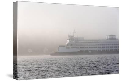 Washington State, Puget Sound. Ferry Emerges from Dense Fog