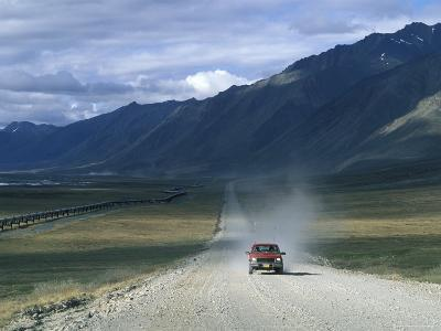 Truck on the Dalton Highway Following the Alyeska Pipeline, Alaska-Rich Reid-Photographic Print