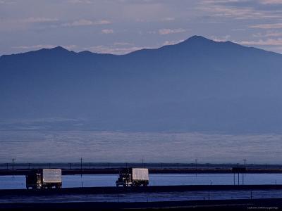 Trucks Along the Highway Next to Great Salt Lake, Utah-Kenneth Garrett-Photographic Print