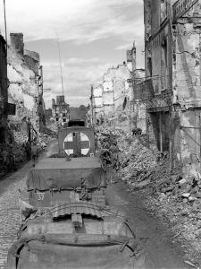 Trucks Driving Through the Ruined Town of Falaise