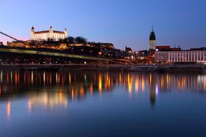 Bratislava Castle and Novy Bridge at Sunset with Reflection by TTstudio