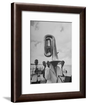 Tuba Player Keeping His Head Dry in a Rainstorm During Visit to St. Croix by Pres. Harry S. Truman-Thomas D. Mcavoy-Framed Photographic Print