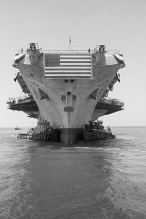 Tugboats Pushing the Aircraft Carrier John F. Kennedy
