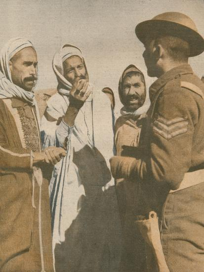 'Tunisian Arabs Welcome a British Sergeant at Chaouach', 1943-Unknown-Photographic Print