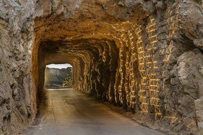 Tunnel on Iron Mountain Road Lit by Setting Sun, Mount Rushmore, South Dakota-Chuck Haney-Photographic Print