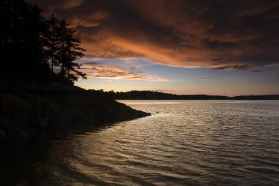 Turbulent Clouds over Water are Cast with Fiery Yellows and Oranges at Sunset-Robbie George-Photographic Print