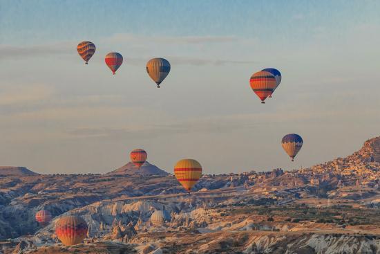 Turkey, Anatolia, Cappadocia, Goreme. Hot air balloons flying above the valley.-Emily Wilson-Premium Photographic Print