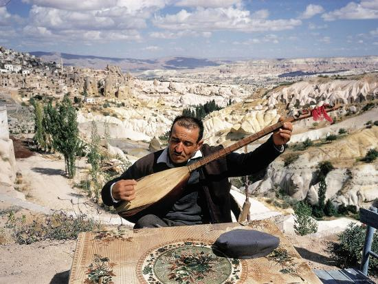 Turkish Man Playing a Type of Mandolin Called a Sis Photographic Print by  Bill Ray | Art com