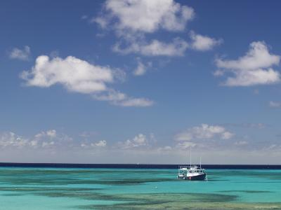 Turquoise Water and Dive Boat, Cockburn Town, Grand Turk Island, Turks and Caicos-Walter Bibikow-Photographic Print