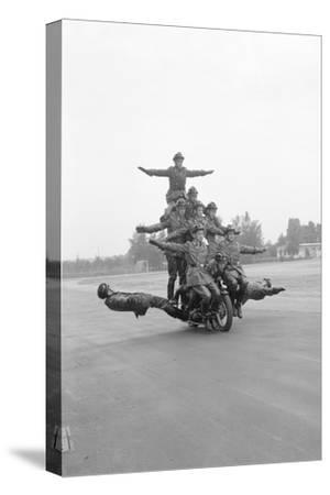 Twelve Policemen Riding One Motorcycle