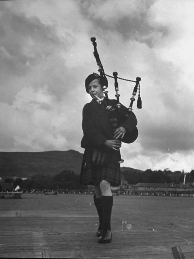 Twelve Year Old Boy Winning First Prize in Both of the Piping Contests Open to Him at Cowal--Photographic Print