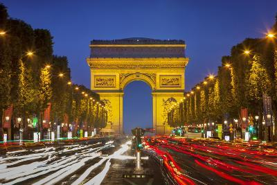 Twilight along Champs Elysee with Arc de Triomphe, Paris, France.-Brian Jannsen-Photographic Print