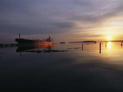 Twilight View of a Ship at Anchor in Still Water at Low Tide-Bill Curtsinger-Photographic Print