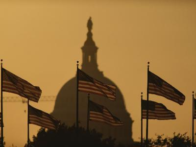 Twilight View of American Flags Flying Near the Capitol Building-Karen Kasmauski-Photographic Print