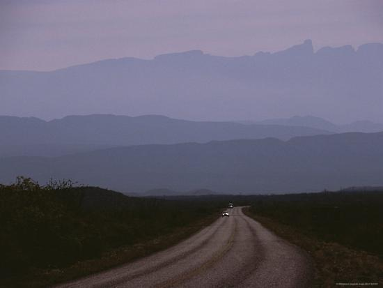 Twilight View of Road Leading to Fog-Shrouded Mountains-Medford Taylor-Photographic Print