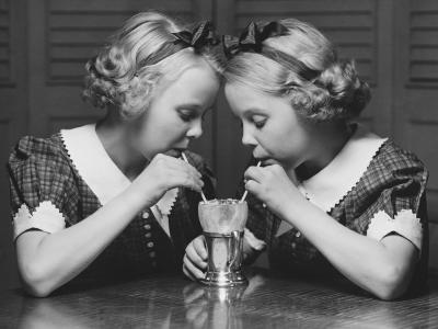 Twin Sisters Drinking Through Straws From Same Glass-George Marks-Photographic Print