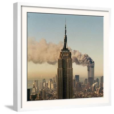 Twin Towers of the World Trade Center Burn Behind the Empire State Buildiing, September 11, 2001--Framed Photographic Print
