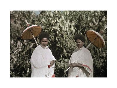 Two Amharic Women Pose Holding Umbrellas to Shade Themselves-W^ Robert Moore-Photographic Print