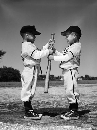 Two Boys in Little League Uniforms, Facing Each Other, Holding Baseball Bat-H^ Armstrong Roberts-Photographic Print