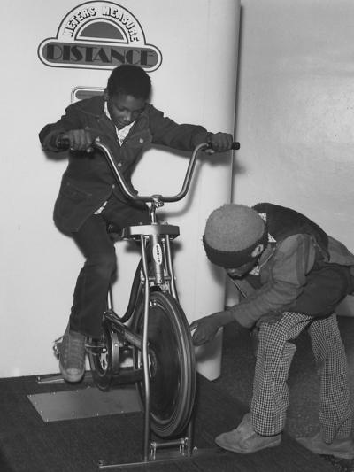 Two Boys Interacting with a Display That Measures Distance in Meters--Photographic Print