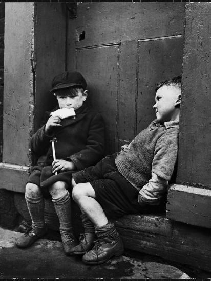 Two Boys Sitting on Doorstep-Nat Farbman-Photographic Print