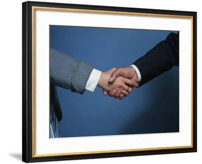 Two Businessmen Shake Hands--Framed Photographic Print