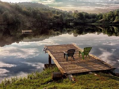 Two Chairs on a Small Dock on a Calm Lake with Cloud Reflections-Amy & Al White & Petteway-Photographic Print