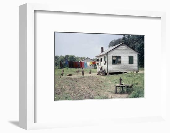 Two Children Stand in a Yard under a Laundry Line, Edisto Island, South Carolina, 1956-Walter Sanders-Framed Photographic Print