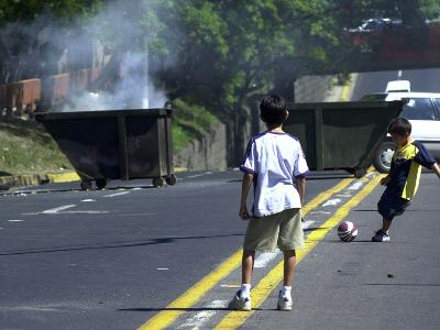 Two Children Take Advantage of a Blockade--Photographic Print