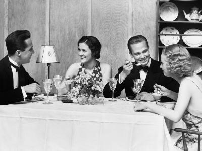 Two Couples Wearing Formal Dress, Sitting at Table Eating and Talking-H^ Armstrong Roberts-Photographic Print