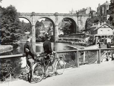 Two Cyclists Take a Break on a Bridge Over the River Nidd at Knaresborough-Fred Musto-Photographic Print