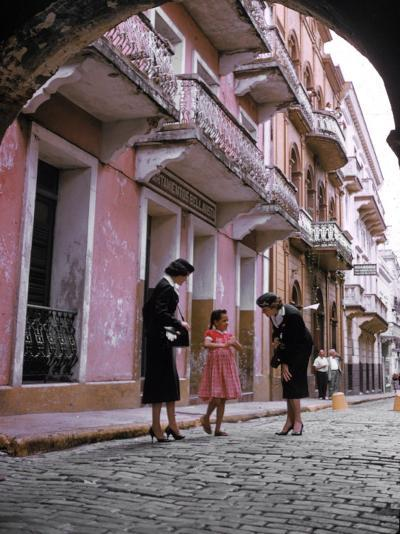 Two Eastern Airlines Stewardesses Talking to Native Girl on Street--Photographic Print