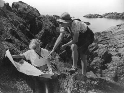 Two Female Hikers on a Coastal Route Stop and Consult their Map--Photographic Print