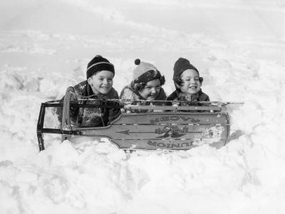 Two Girls and One Boy Lying on Belly in Snow Using Sled As Shield-H^ Armstrong Roberts-Photographic Print