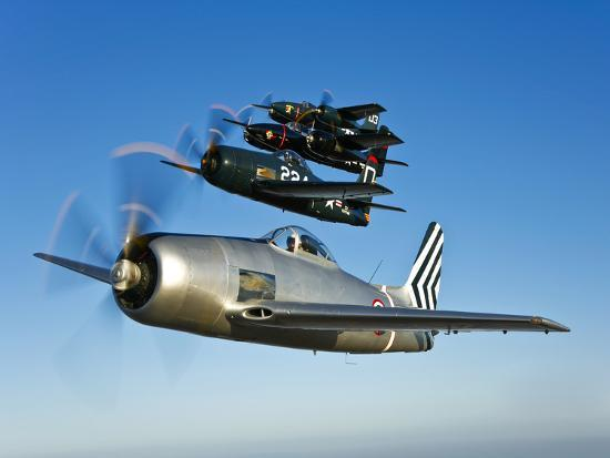 Two Grumman F8F Bearcats and Two F7F Tigercats Fly in Formation-Stocktrek Images-Photographic Print