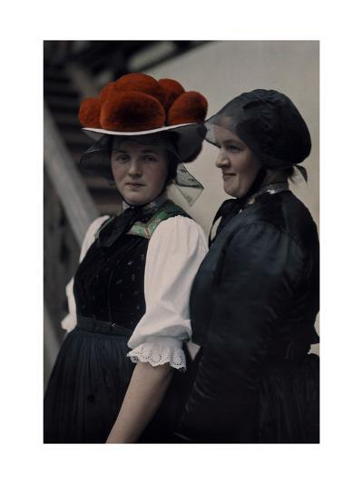 Two Gutach Women Pose Wearing a Black Bonnet and a Pompon Hat-Hans Hildenbrand-Photographic Print