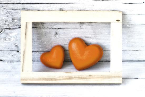 Two Hearts Made of Stone in Picture Frame-Uwe Merkel-Photographic Print