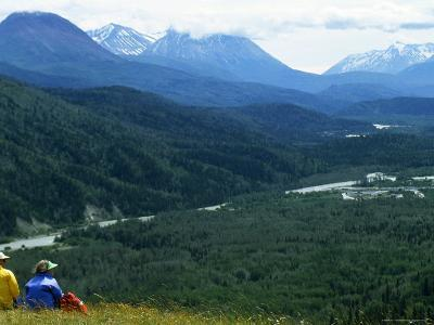 Two Hikers Stop and Relax to Enjoy the Valley View, Alaska-Kate Thompson-Photographic Print