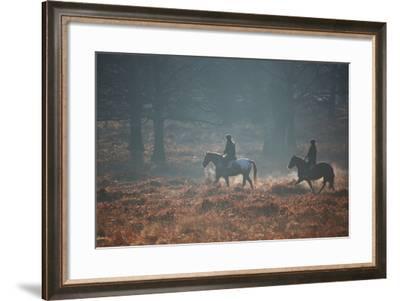 Two Horseback Riders Make their Way Through Misty Richmond Park in Winter-Alex Saberi-Framed Photographic Print