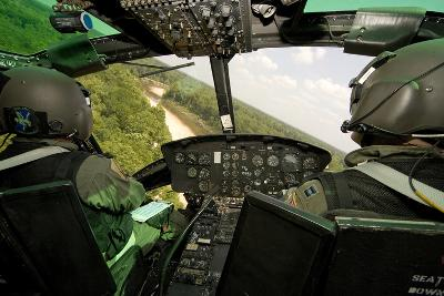 Two Instructor Pilots Practice Low Flying Operations in a Uh-1H Huey Helicopter--Photographic Print