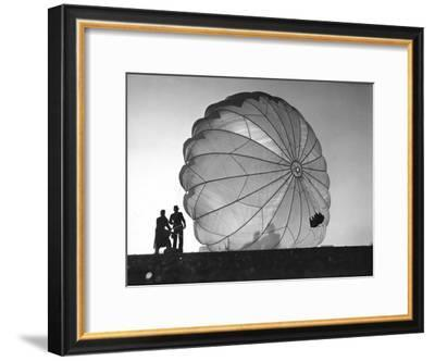 Two Irving Air Chute Co. Employees Struggling to Pull Down One of their Parachutes after Test Jump-Margaret Bourke-White-Framed Premium Photographic Print