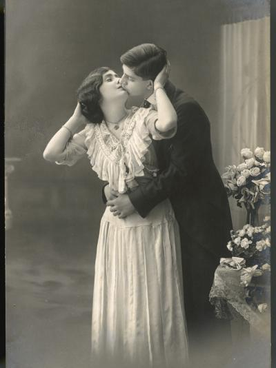 Two Lovers Embrace and Kiss--Photographic Print