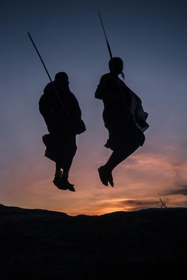 Two Masaai Warriors Silhouetted Performing Traditional Jump - Leap Kopje at Sunset-Nick Garbutt-Photographic Print