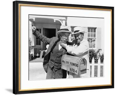 Two Mature Men Fighting Near a Mail Box in Front of a House--Framed Photo