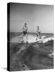 Two Men Behind Boat Which Is Not Seen, Water Skiing
