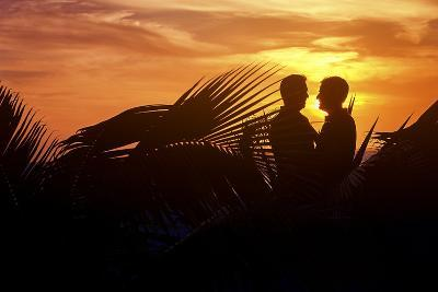 Two Men Embrace after their Beach Wedding in Mexico-Michael Lewis-Photographic Print